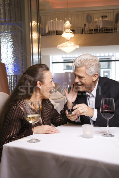 Mature man proposing to woman. Stock photo © iofoto