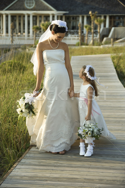 Bride and flower girl walking. Stock photo © iofoto
