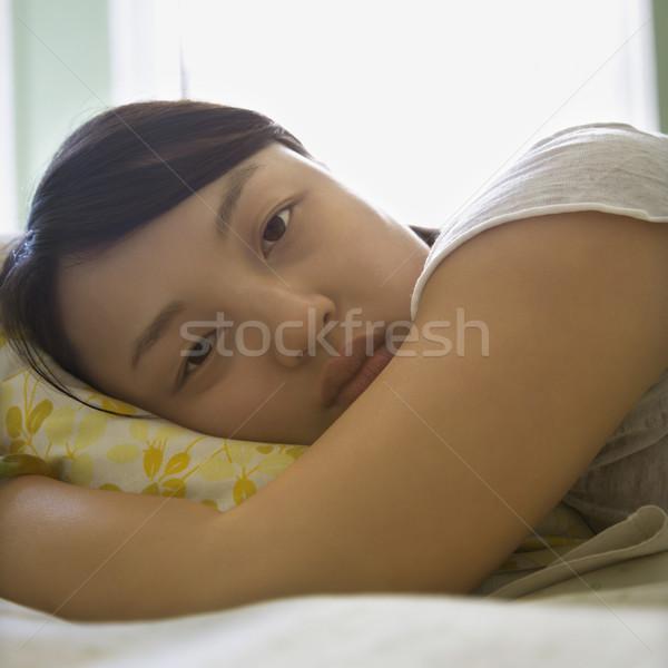 Kobieta bed portret dość młodych asian Zdjęcia stock © iofoto
