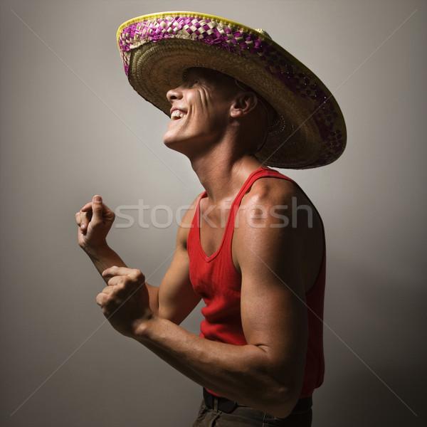Dancing man wearing sombrero. Stock photo © iofoto