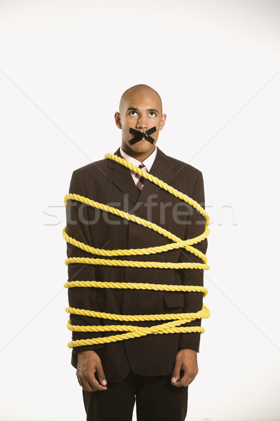 Businessman tied in rope. Stock photo © iofoto