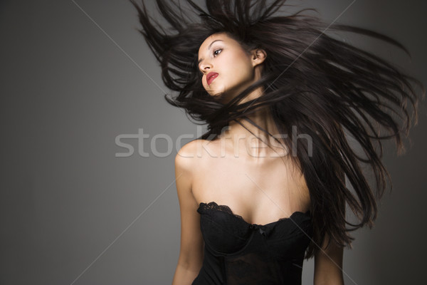 Woman flinging long hair. Stock photo © iofoto