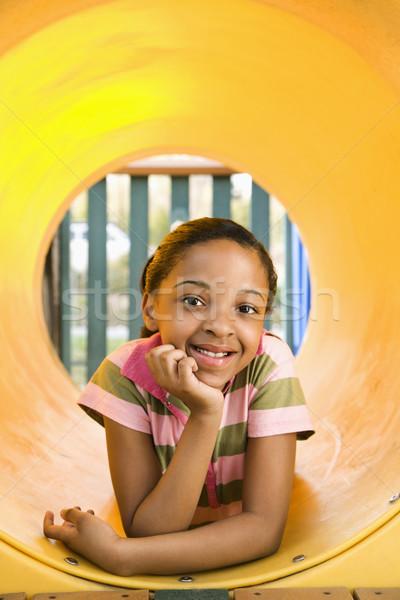 Genç kız oyun alanı gülen sarı tüp Stok fotoğraf © iofoto