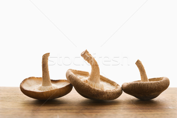 Stock photo: Three mushrooms.