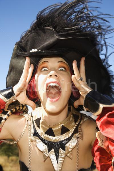 Woman making facial expression. Stock photo © iofoto
