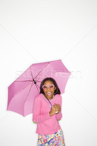 Cute girl holding umbrella. Stock photo © iofoto