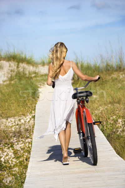 Girl Walking Bike on Boardwalk Stock photo © iofoto