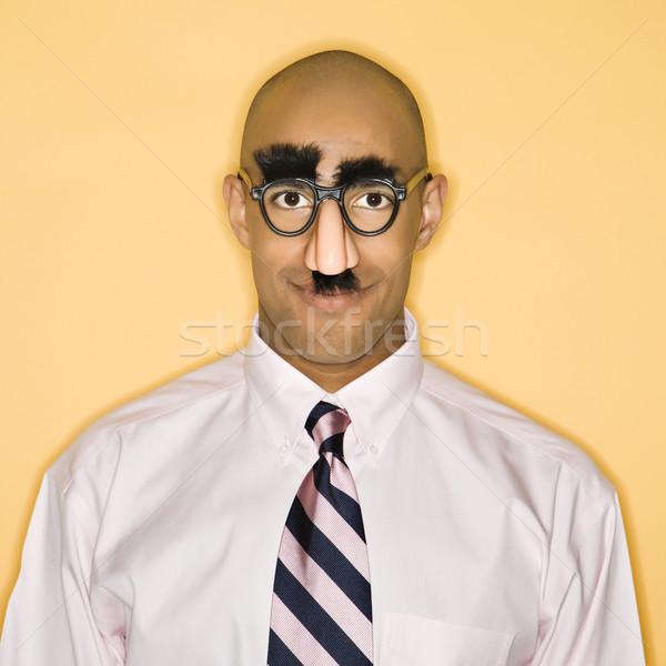 Man vermommen afro-amerikaanse masker zakenman Stockfoto © iofoto