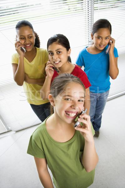 Girls on cell phones. Stock photo © iofoto