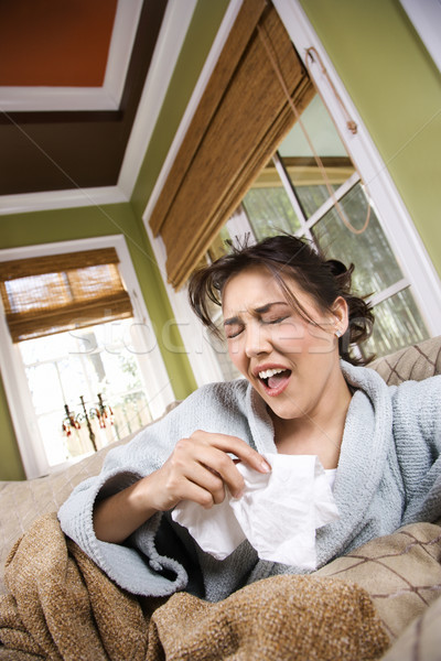 Young Sick Woman Sneezing Stock photo © iofoto