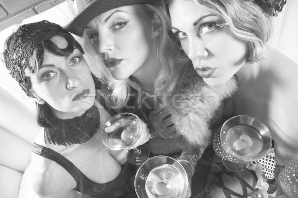 Retro women with martinis. Stock photo © iofoto