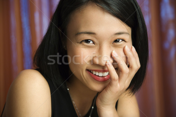 Smiling pretty young woman. Stock photo © iofoto