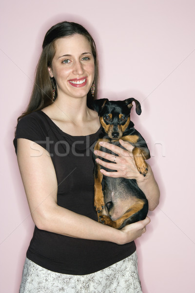Woman holding Miniature Pinscher dog. Stock photo © iofoto