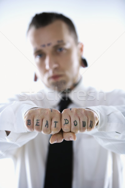 Man with fists reading beat down. Stock photo © iofoto