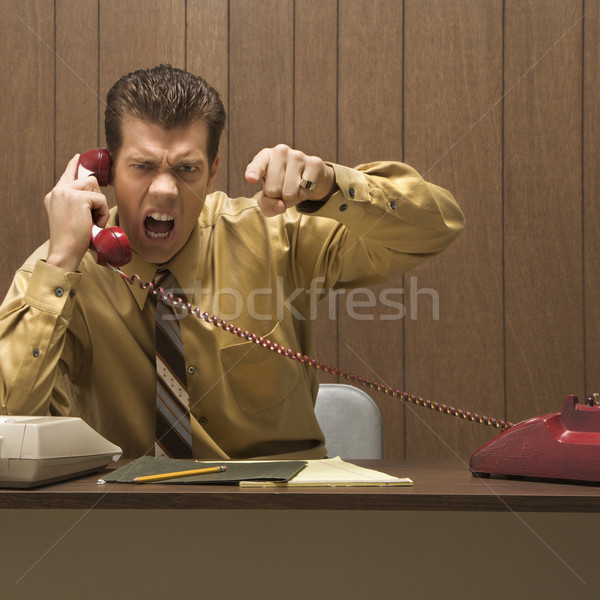 Angry businessman. Stock photo © iofoto