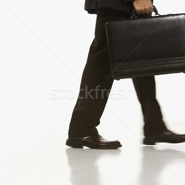 Businessman carrying briefcase. Stock photo © iofoto