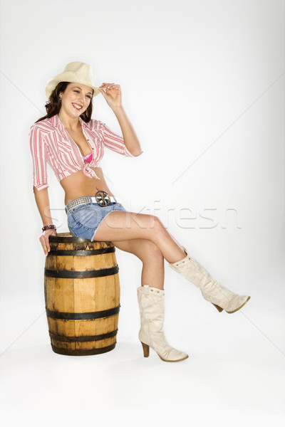 Cowgirl sitting on barrel. Stock photo © iofoto