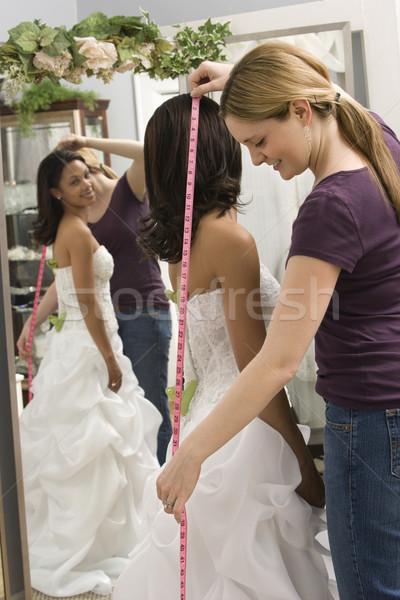 Seamstress measuring bride. Stock photo © iofoto