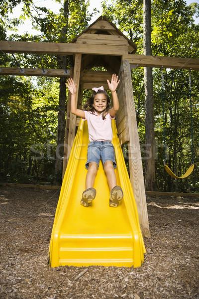 Gelukkig meisje latino meisje beneden outdoor slide Stockfoto © iofoto
