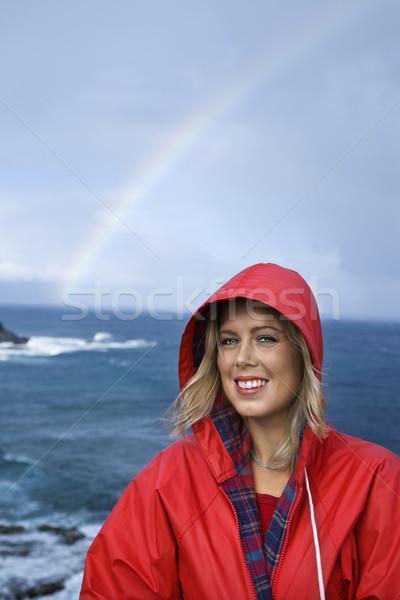 Vrouw regenboog kaukasisch Rood regenjas oceaan Stockfoto © iofoto