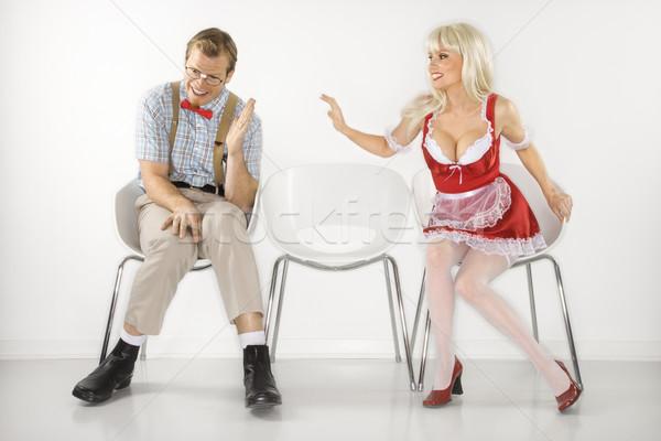 Woman flirting with shy man. Stock photo © iofoto