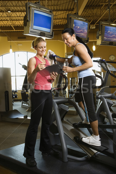 Woman with fitness trainer. Stock photo © iofoto