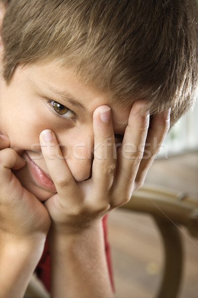 Stock photo: Boy with hand over face.