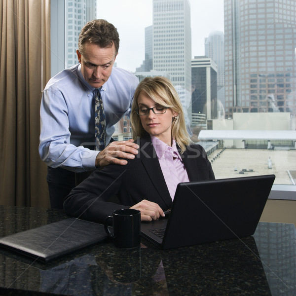 Businessman Annoying Businesswoman Stock photo © iofoto