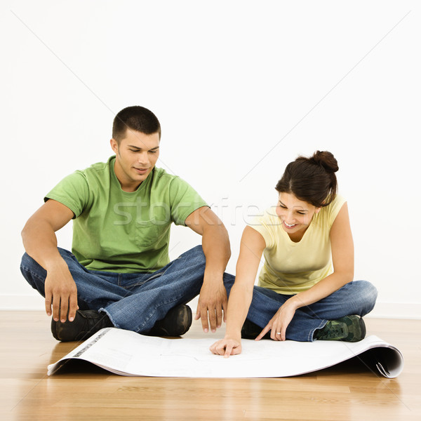Couple with blueprints. Stock photo © iofoto