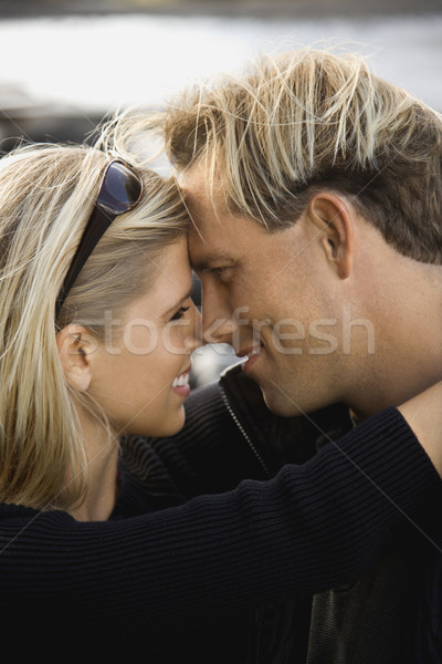 Young couple embracing. Stock photo © iofoto