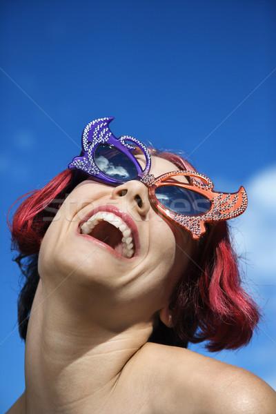 Woman wearing unique sunglasses. Stock photo © iofoto