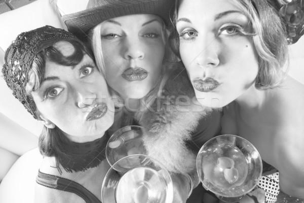 Retro women with drinks. Stock photo © iofoto