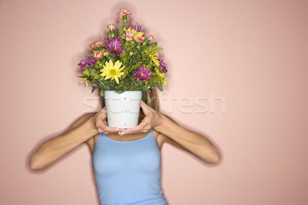 Woman with flower pot. Stock photo © iofoto