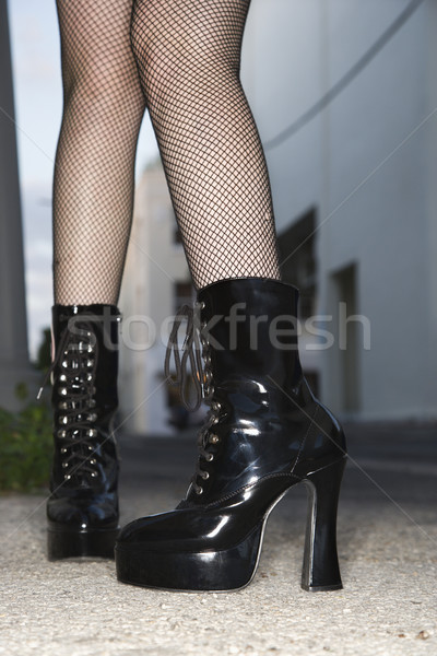 Woman wearing boots. Stock photo © iofoto