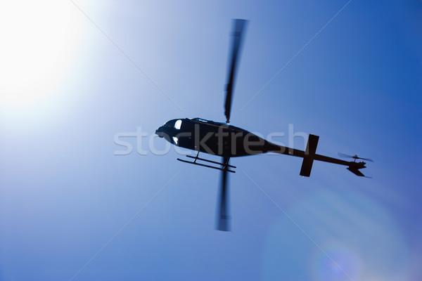 Fekete helikopter repülés alulról fotózva mozgás lövés Stock fotó © iofoto
