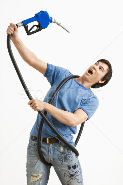 Man attacked by gas nozzle. Stock photo © iofoto