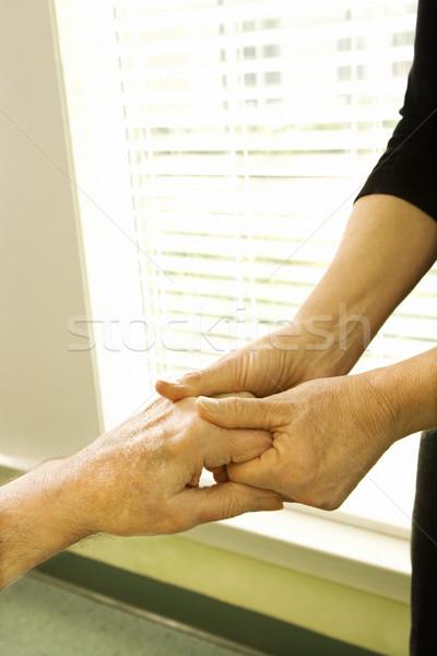Woman holding mature woman's hand. Stock photo © iofoto