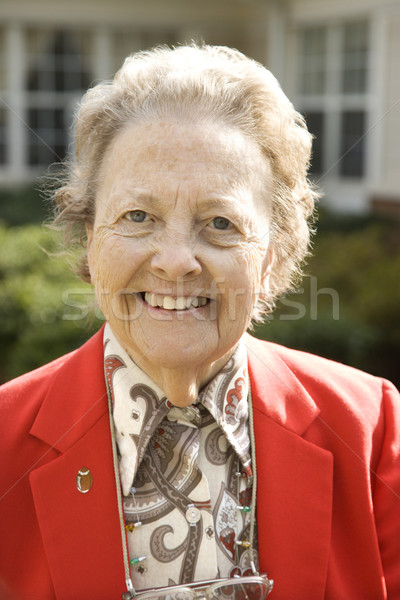 Elderly Woman in Red Coat Outdoors Smiling Stock photo © iofoto