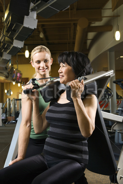 Woman at gym with trainer. Stock photo © iofoto