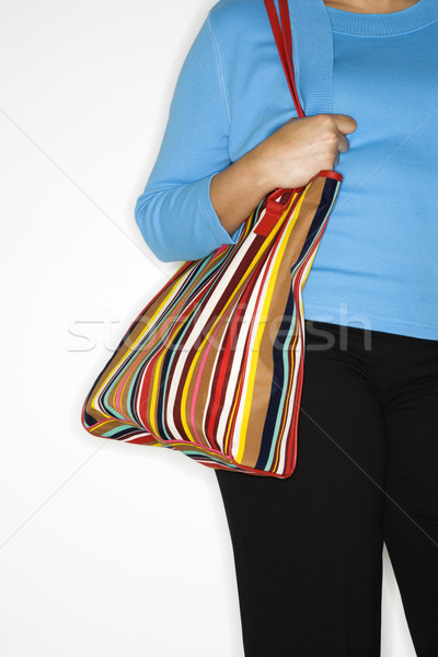 Woman holding big purse. Stock photo © iofoto