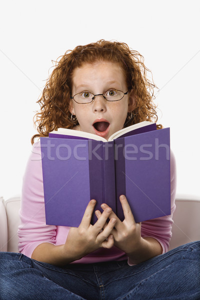 Lány olvas néz meglepődött kaukázusi női Stock fotó © iofoto