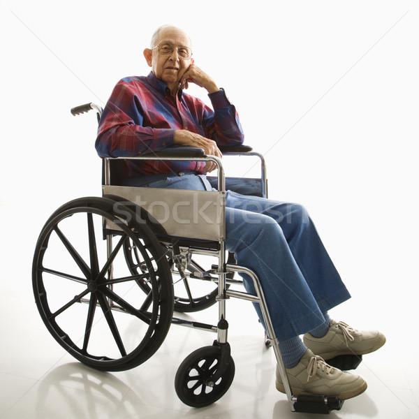 Elderly man in wheelchair. Stock photo © iofoto