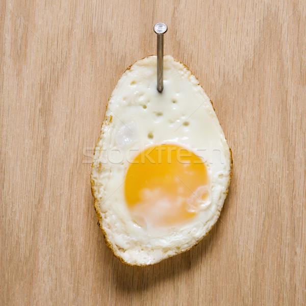 Fried egg with nail. Stock photo © iofoto