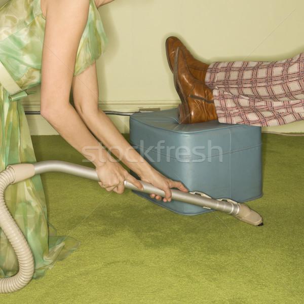Woman vacuuming rug. Stock photo © iofoto