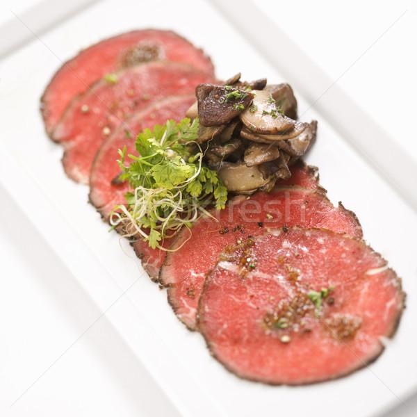 Beef carpaccio with mushrooms. Stock photo © iofoto