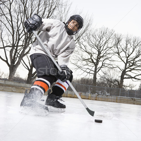 Boy playing ice hockey. Stock photo © iofoto