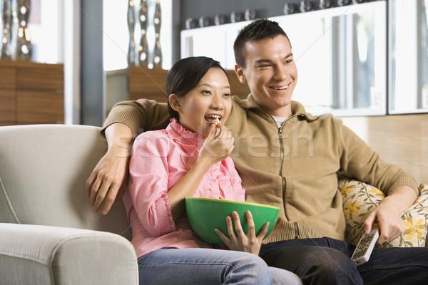 Couple watching TV. Stock photo © iofoto