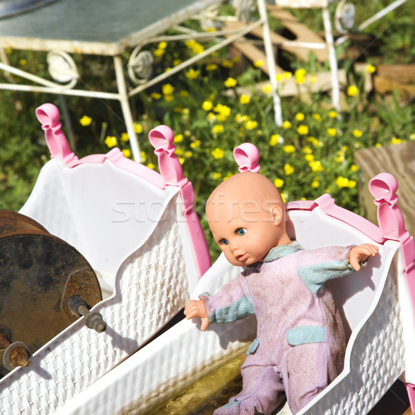 Baby doll in crib. Stock photo © iofoto
