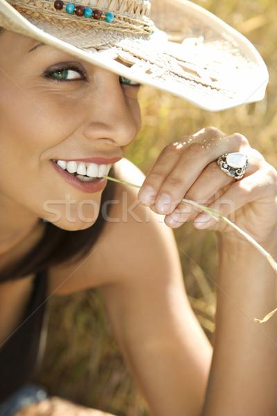 Woman chewing on straw. Stock photo © iofoto