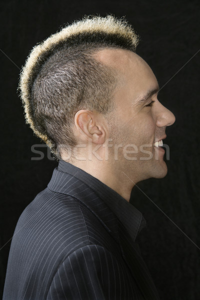 Businessman with punk mohawk. Stock photo © iofoto